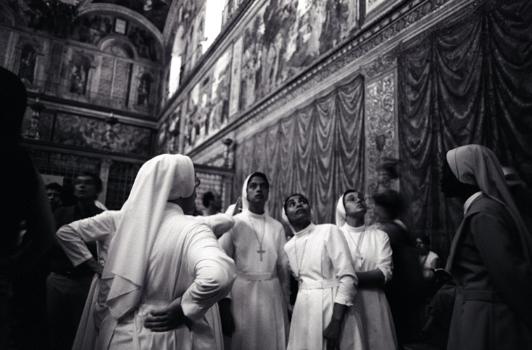 Nuns admiring the ceiling at the Sistine Chapel, Rome